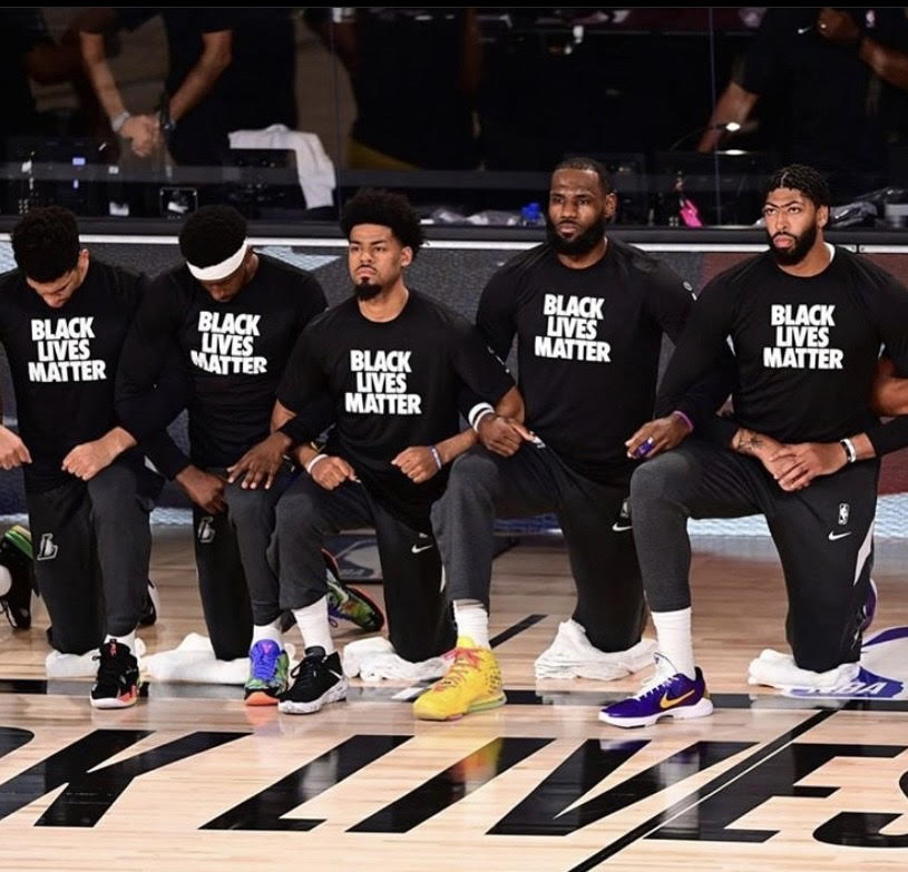 Members of the Los Angles Lakers kneeling during the national anthem in the NBA Bubble